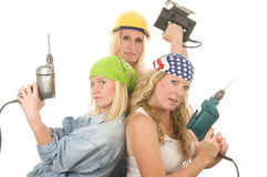 Team contractor   ladies tools. Group of sexy contractor or builder or homemaker females construction workers with electric power tools Stock Photos