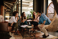 Team of corporate professionals having discussion in meeting. Multi ethnic business team having project discussion Royalty Free Stock Image