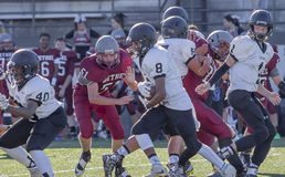 Football Defense. A team covering their players so they can get the ball across the field stock images