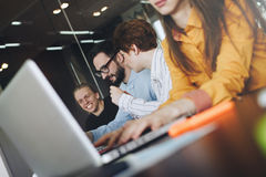 Team of coworkers IT professionals working in modern loft on software development royalty free stock photography