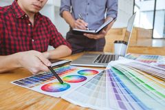 Team of Creative graphic designer meeting working on new project royalty free stock photography