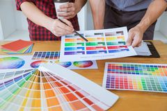 Team of Creative graphic designer meeting working on new project, choose selection color and drawing on graphics tablet with work stock image