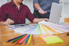 Team of Creative graphic designer meeting working on new project, choose selection color and drawing on graphics tablet with work. Tools and accessories royalty free stock photo