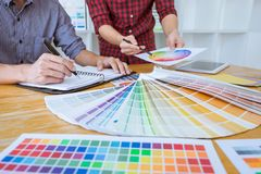 Team of Creative graphic designer meeting working on new project, choose selection color and drawing on graphics tablet with work royalty free stock photography