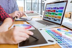 Team of Creative graphic designer meeting working on new project, choose selection color and drawing on graphics tablet with work royalty free stock photo