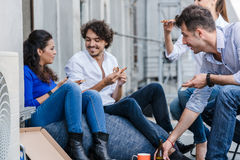 Team of Creative industries agency during lunch at office balcon Stock Images