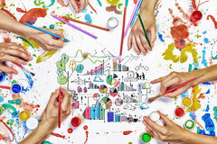 Team creative work. Top view of people hand drawing business creative concept with paints stock photography