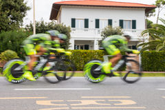 Team of cyclists blurred for speed in a chrono bicycle race Stock Photo