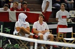 The team of Denmark resting at a Davis Cup match against Romania. The tennis team of Romania (players: Horia Tecau and Florin Mergea) wins against Denmark ( Royalty Free Stock Photos