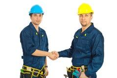 Team der Erbauerarbeitskräfte geben Händedruck Lizenzfreies Stockbild