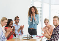 Team of designers applauding at the camera Royalty Free Stock Photography