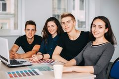 Team of designers sitting together at studio stock image