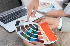 Team of designers working with color palette stock photography