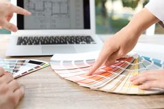 Team of designers working with color palette at office table royalty free stock images