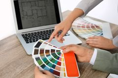 Team of designers working with color palette. At office table, closeup royalty free stock image