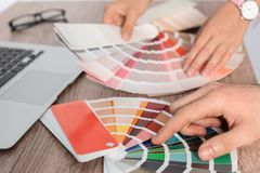 Team of designers working with color palettes at office table stock image