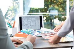 Team of designers working with color palettes at office table. Closeup royalty free stock images