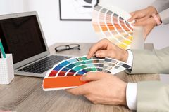 Team of designers working with color palettes. At office table, closeup royalty free stock photos