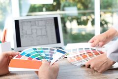 Team of designers working with color palettes stock image