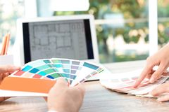 Team of designers working with color palettes. At office table, closeup stock photo