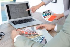 Team of designers working with color palettes. At office table, closeup royalty free stock photo