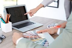 Team of designers working with color palettes. At office table, closeup stock images