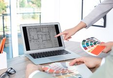 Team of designers working with color palettes. At office table, closeup stock image