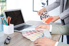 Team of designers working with color palettes. At office table, closeup stock photos
