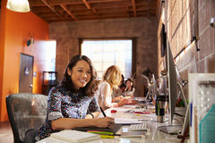 Team Of Designers Working At Desks In Modern Office Royalty Free Stock Photo