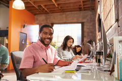 Team Of Designers Working At Desks In Modern Office Stock Photography