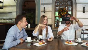 Team of developers working with virtual reality glasses during a business meeting. Young business colleagues. Brainstorming using VR goggles stock video