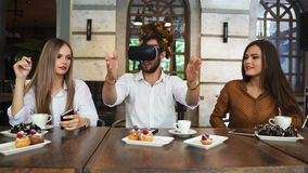 Team of developers working with virtual reality glasses during a business meeting. Young business colleagues. Brainstorming using VR goggles stock video footage