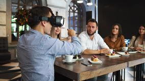 Team of developers working with virtual reality glasses during a business meeting. Young business colleagues stock video footage