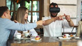 Team of developers working with virtual reality glasses during a business meeting. Young business colleagues. Brainstorming using VR goggles stock footage