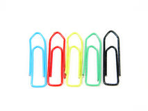 A team of different but actually equal paper-clips. Different colors... but equal Stock Photos