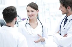 Team of different doctors having conversation royalty free stock photography