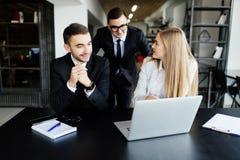 Team discuss information Stock Photos