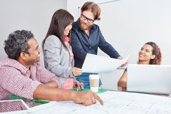 Team discuss project ideas. For business concept planning Stock Photos