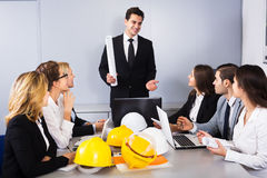 Team of discussing engineers Royalty Free Stock Photography