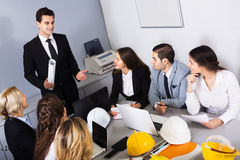 Team of discussing engineers Stock Image