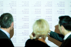 Team discussing the spreadsheet Royalty Free Stock Photo