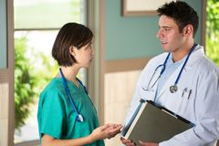 Team of diverse healthcare providers. Team of diverse healthcare providers discussing patients Stock Image