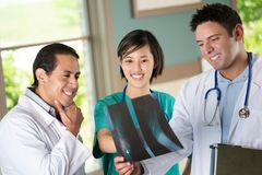Team of diverse healthcare providers. Team of diverse healthcare providers helping patients Stock Image