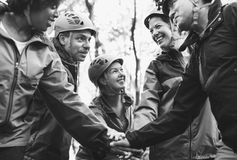 Team of diverse hikers stacking hands together stock images