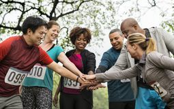 Team of diverse people ready for a race royalty free stock photo