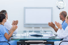 Team of doctor applauding during meeting Royalty Free Stock Photo