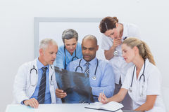 Team of doctors analyzing xray Stock Photo