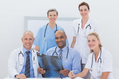 Team of doctors analyzing xray Royalty Free Stock Images
