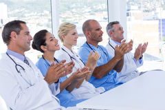 Team of doctors applauding during meeting Stock Photo