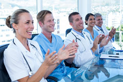 Team of doctors applauding Royalty Free Stock Photography